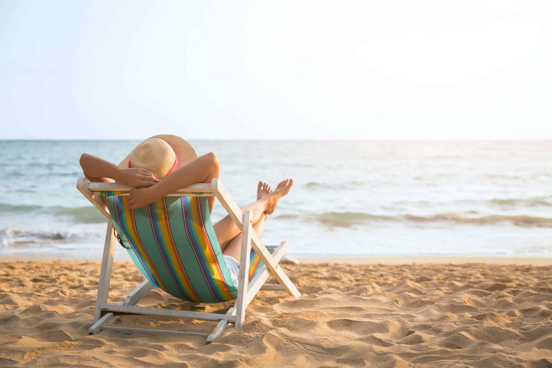 Woman in UK beach in summer