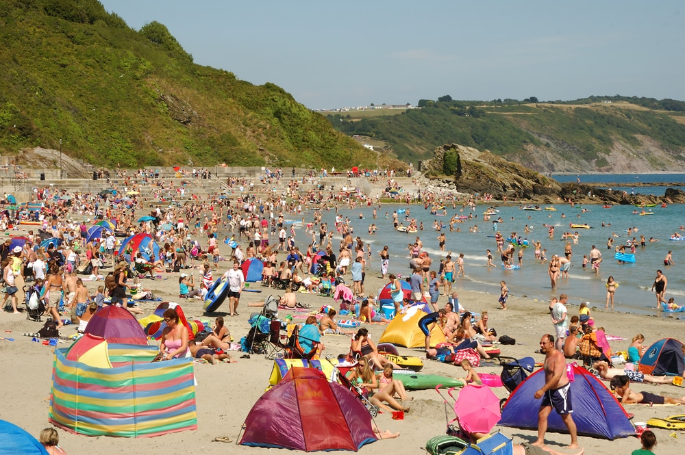 Large British, busy beach during heatwave