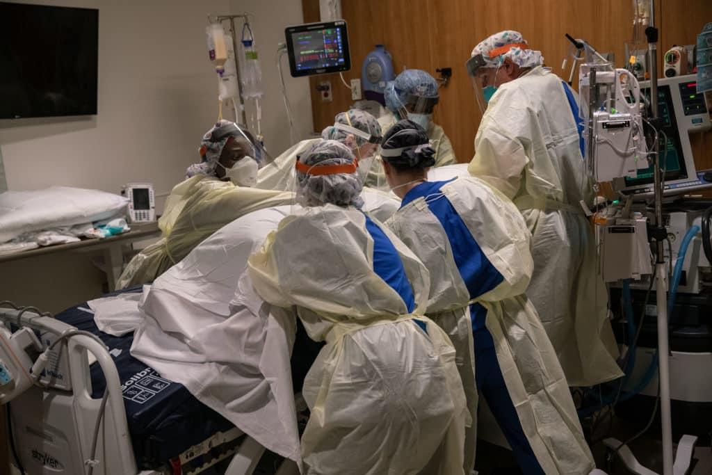 Medical professionals treating coronavirus patient