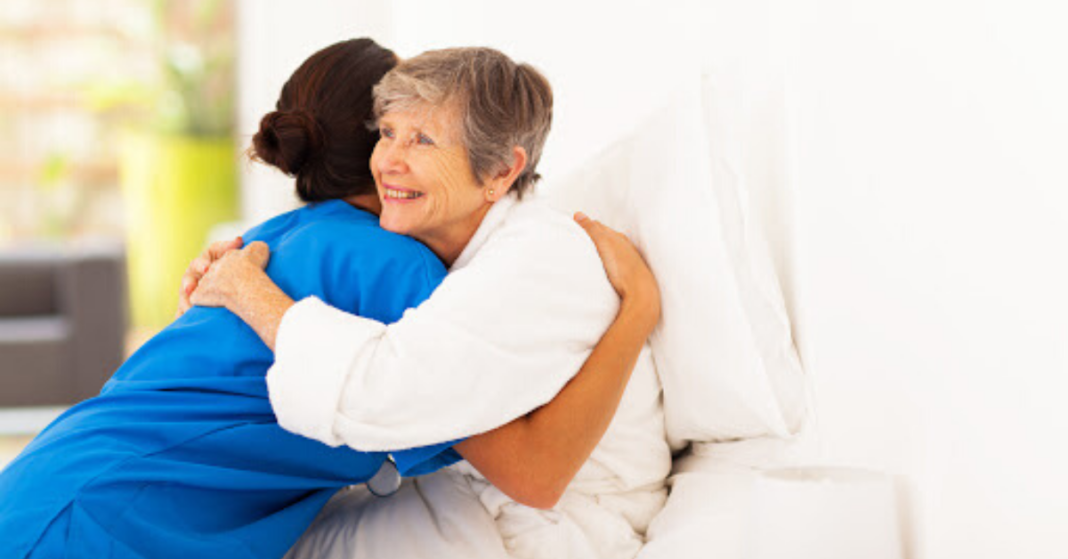 Nurse hugging patient