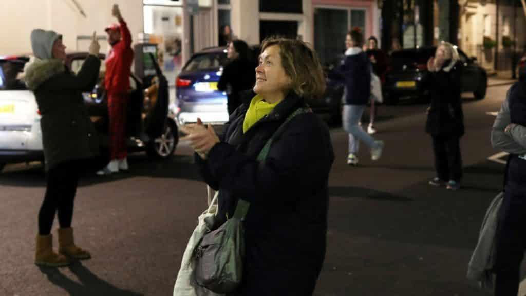 Clapping in street for coronavirus